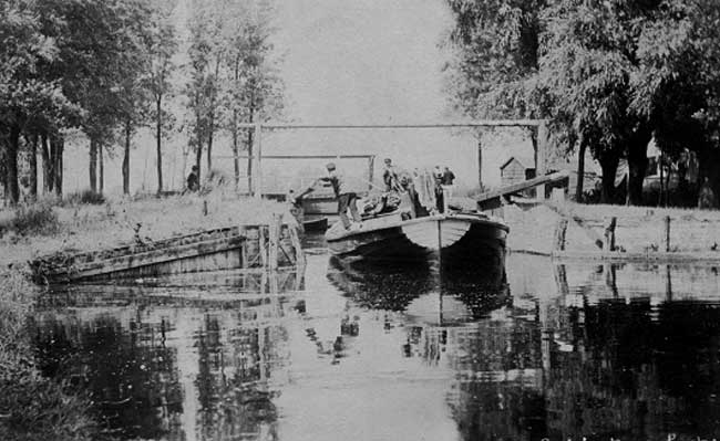 Old photo of a wherry leaving the lock