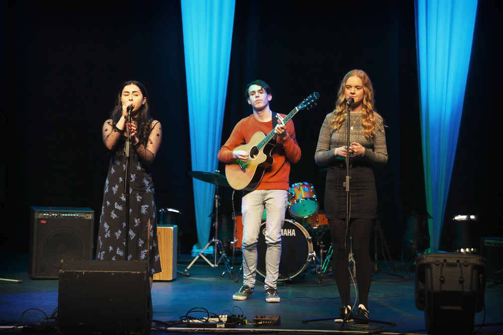 Students perform the second broads album