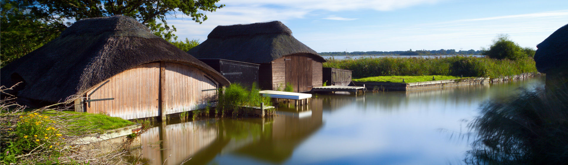 Thatched boat sheds on the edge of Hickling Broad